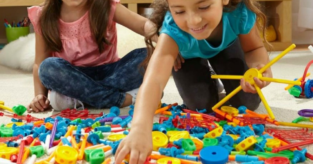 girls playing with TinkerToys