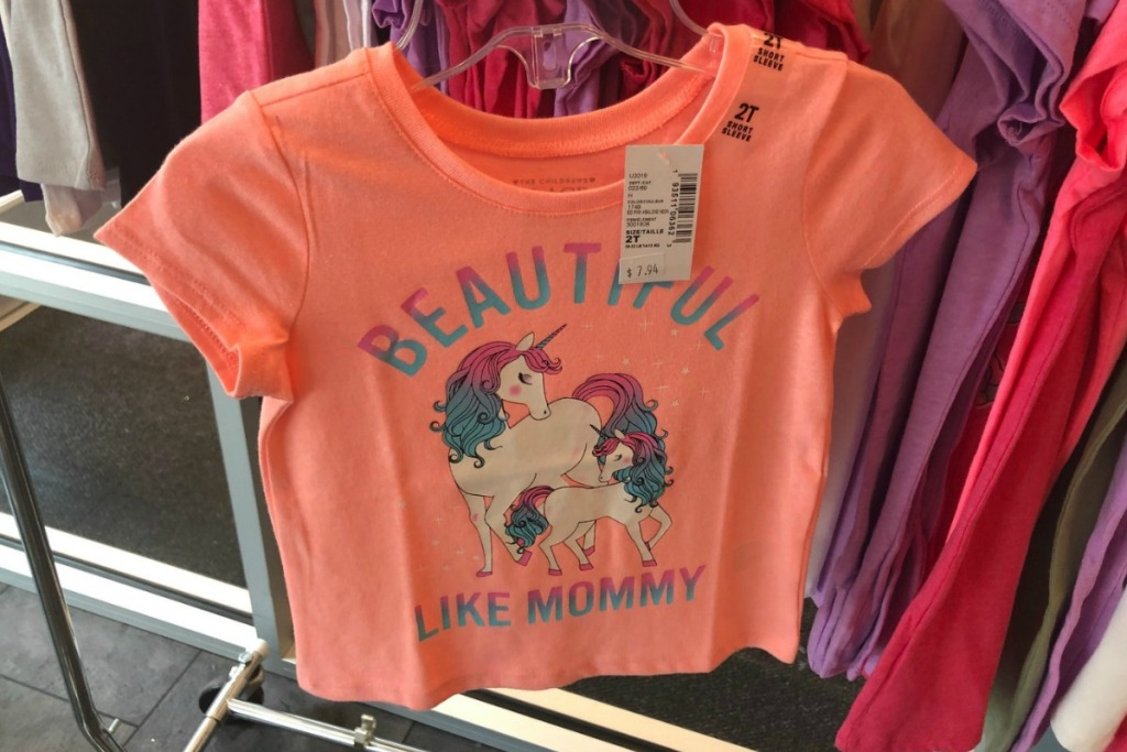unicorn-themed coral colored toddler's graphic tee in store