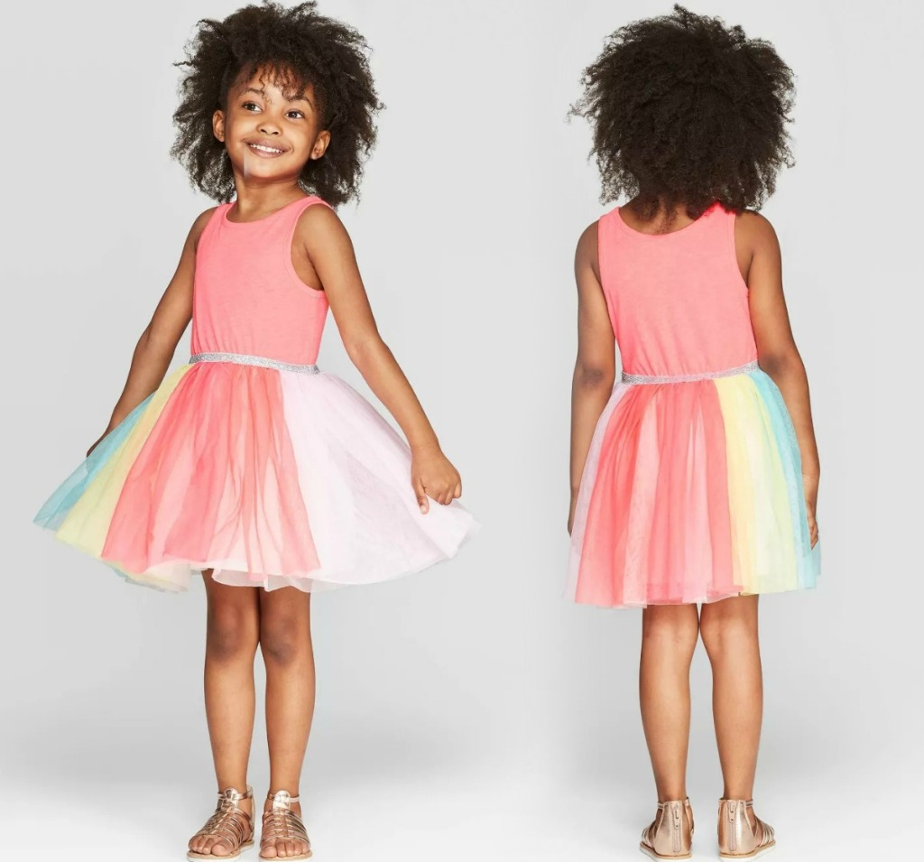 Girl posing in rainbow tulle dress from Target