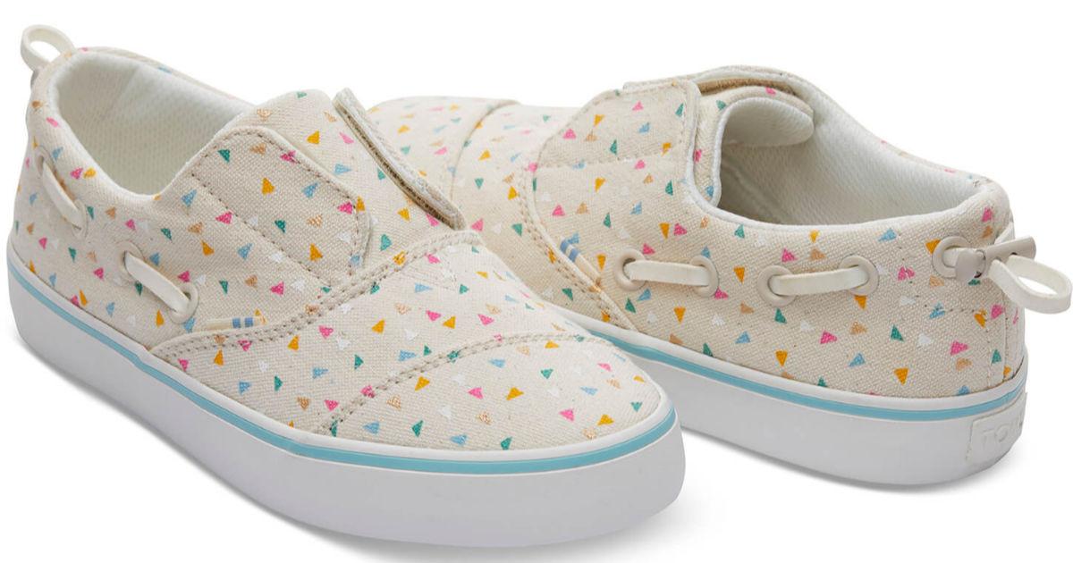 Pair of Tom's funfetti shoes