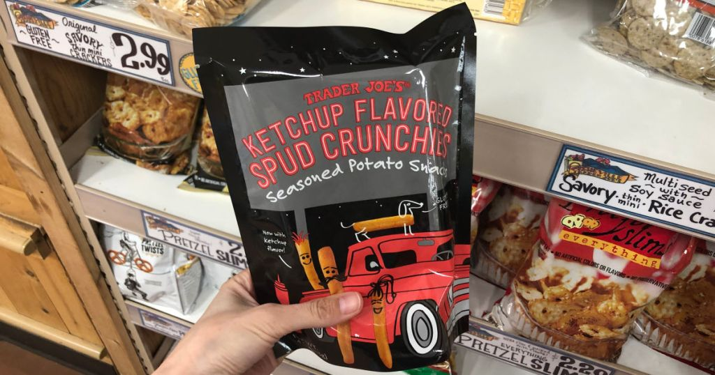 hand holding Trader Joes Ketchup Flavored Spud Crunchies in store
