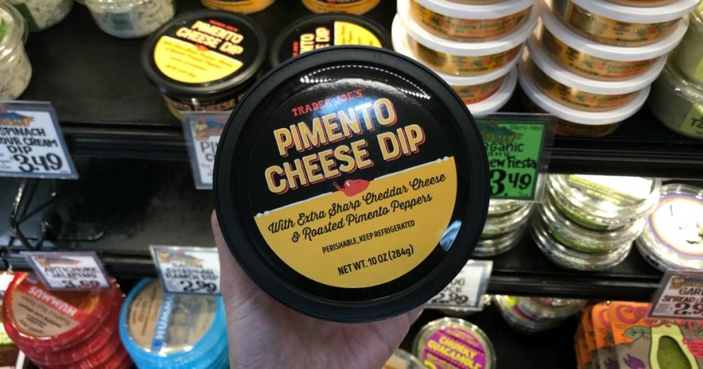 Woman holding Trader Joe's Pimento Cheese Dip