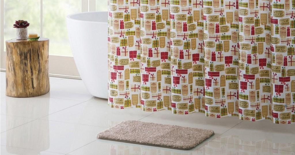 shower curtain, rug, and bathrrom decor in bathrrom