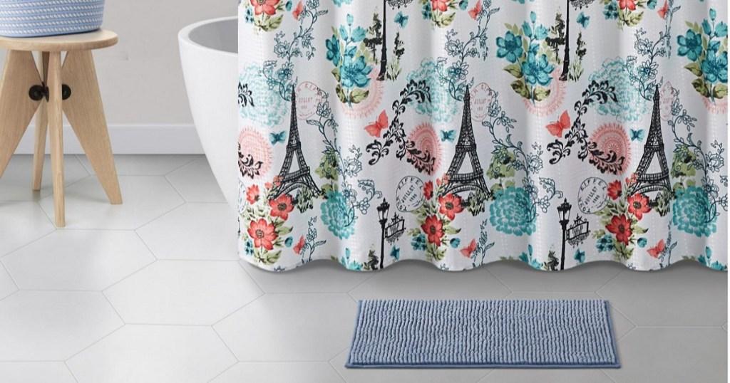 shower curtain, rug and bathroom decor in bathroom