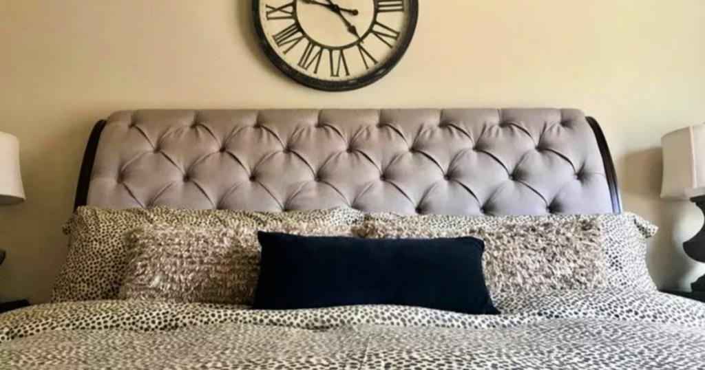 velvet throw pillow on bed