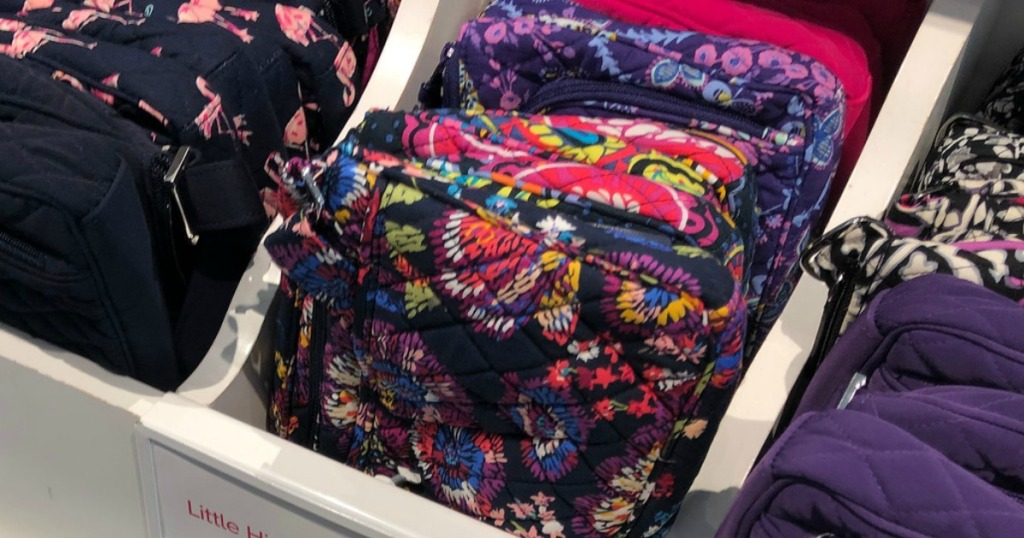 Vera Bradley Little Hipster bags in display bin at store