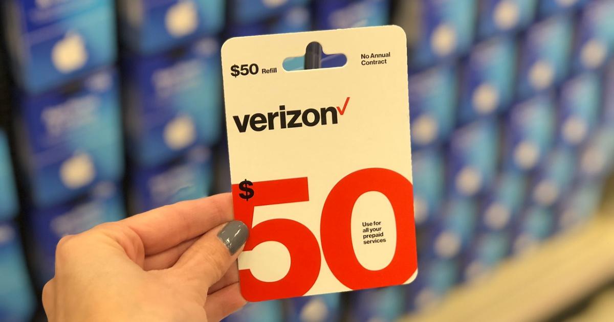 woman holding verizon prepaid card at store