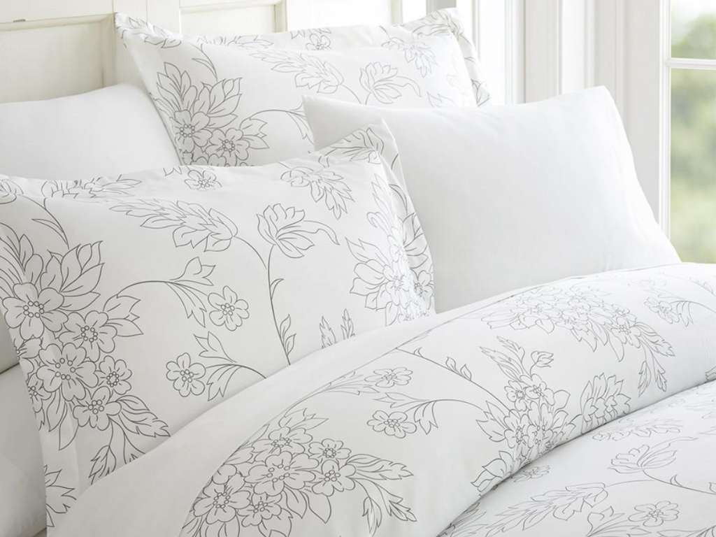 Vines Patterned 3-Piece Duvet Cover Set Grey with pillows on bed