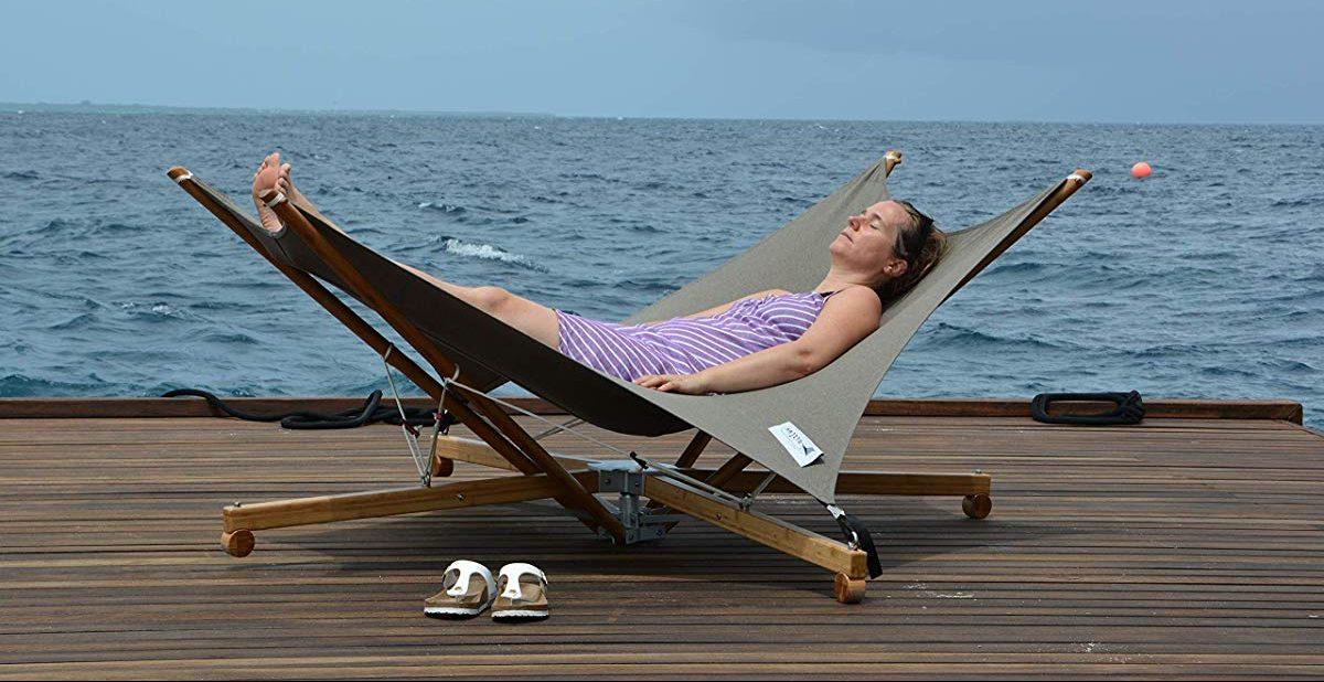 woman laying on hammock
