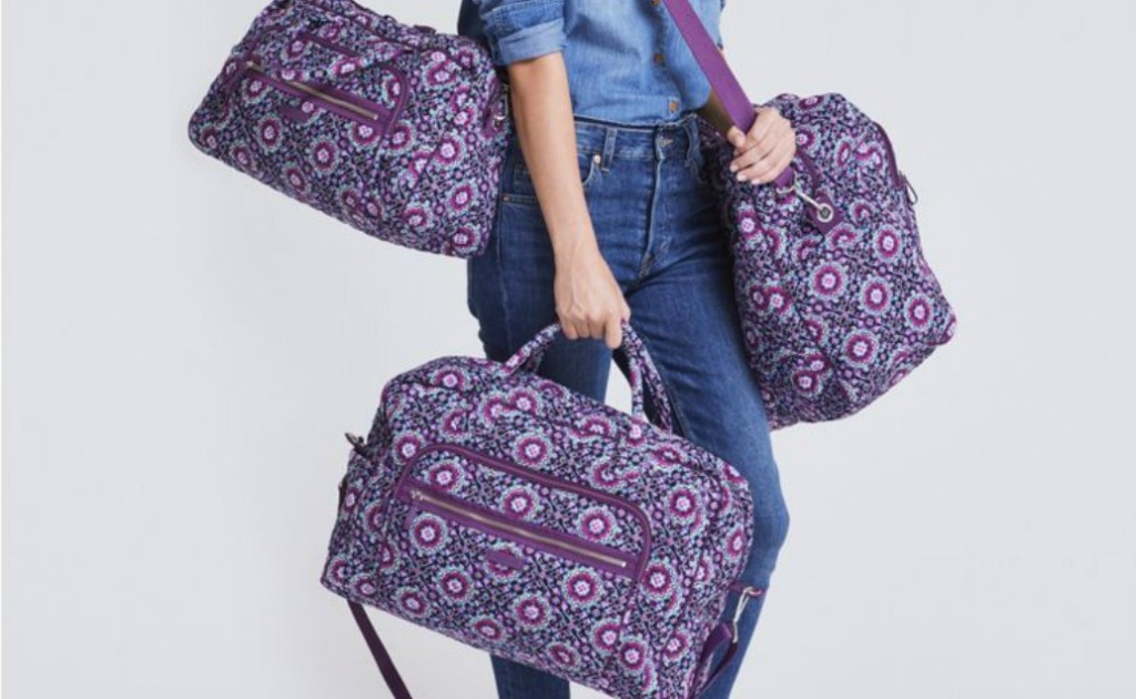 woman carrying several Weekender totes