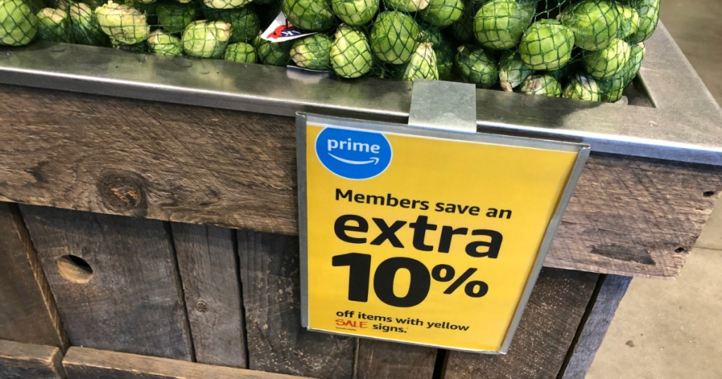 whole foods extra 10% off sign with brussel sprouts