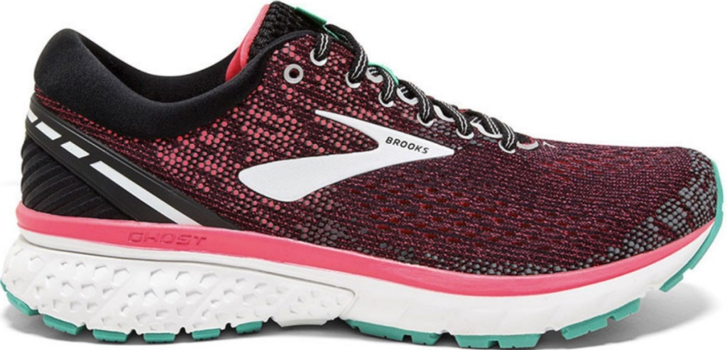 Women's running shoe in pink and black with a teal sole