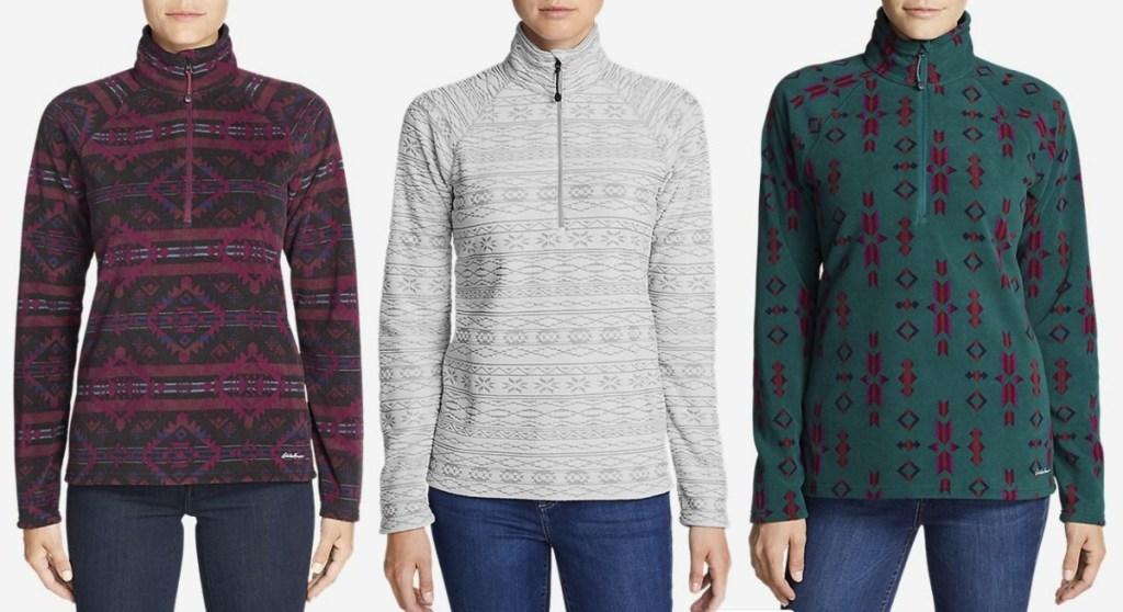 Three women wearing fleece quarter zip pull overs