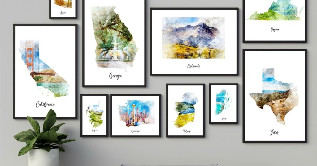 watercolor map prints hung in arrangement on wall