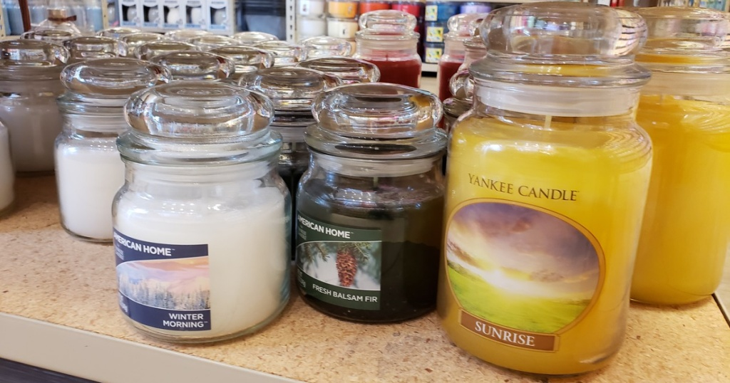 multiple yankee candles on shelf at store