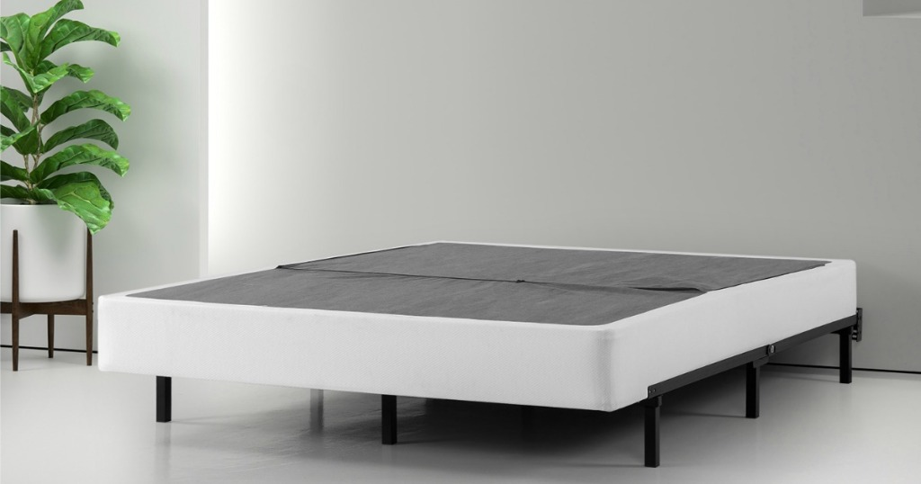 Zinus Box spring shown on frame in bedroom