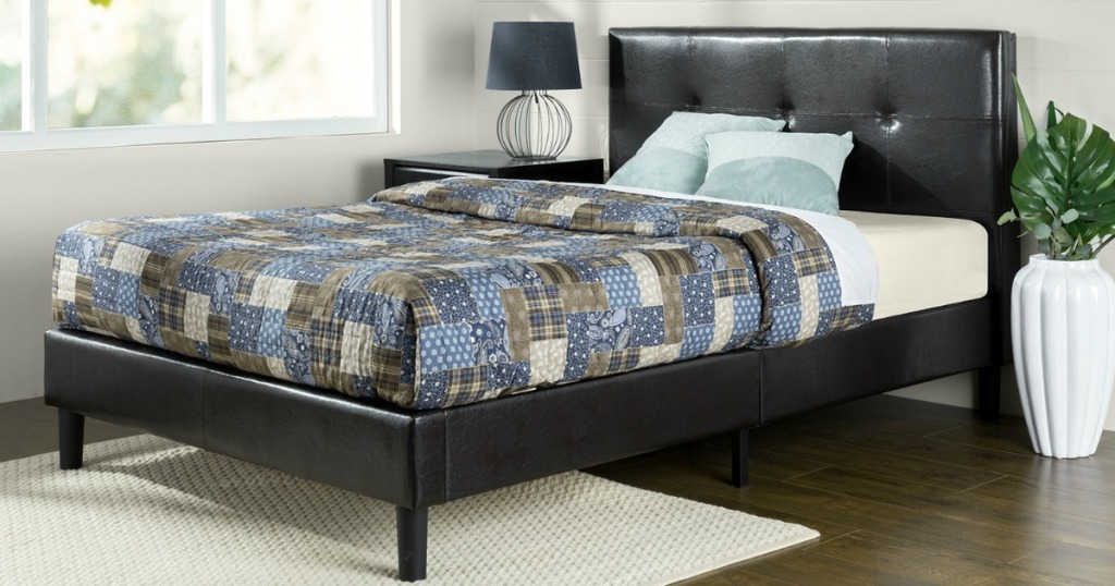 leather platform bed with headboard, mattress and patchwork quilt in bedroom