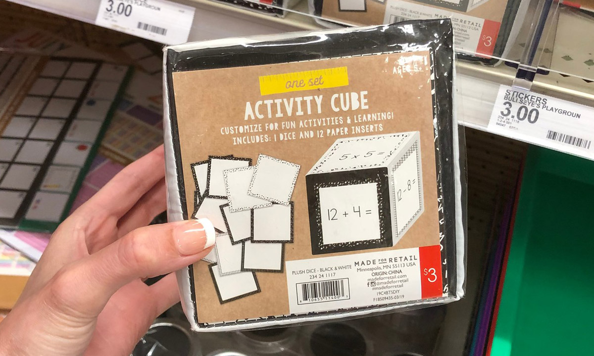 activity cube being held in hand at a target store