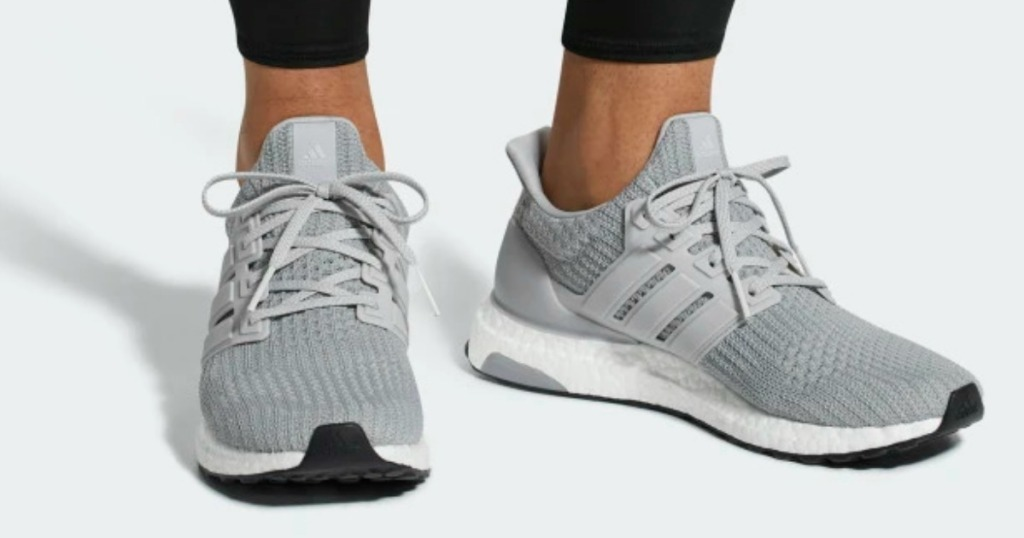 Man wearing adidas men's running shoes in gray