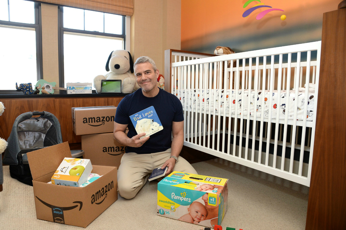 man holding baby products for amazon baby registry