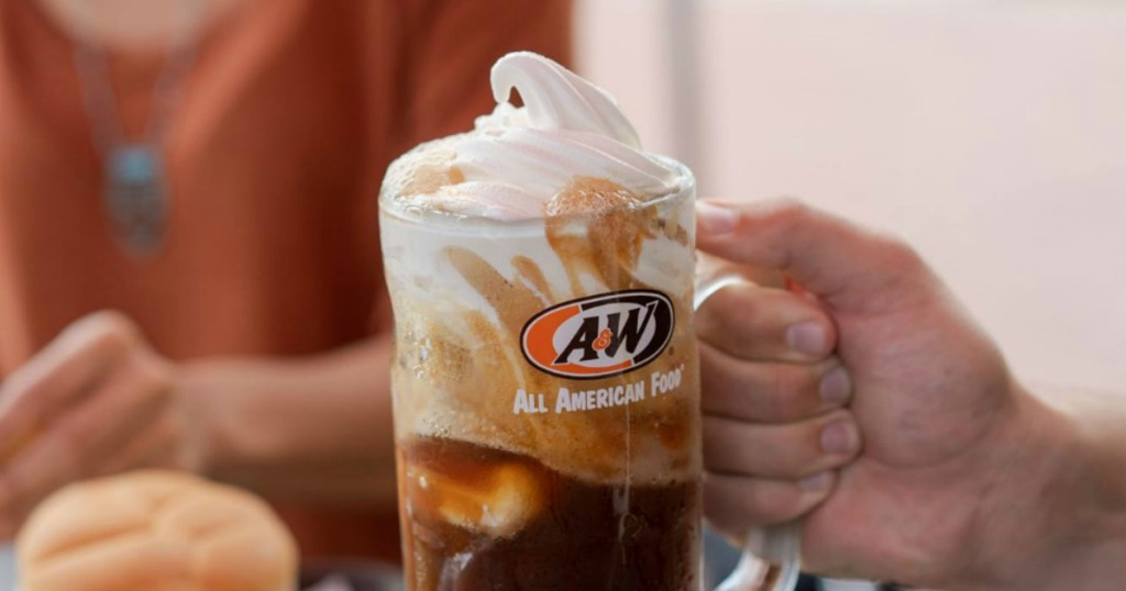 person holding a root beer float