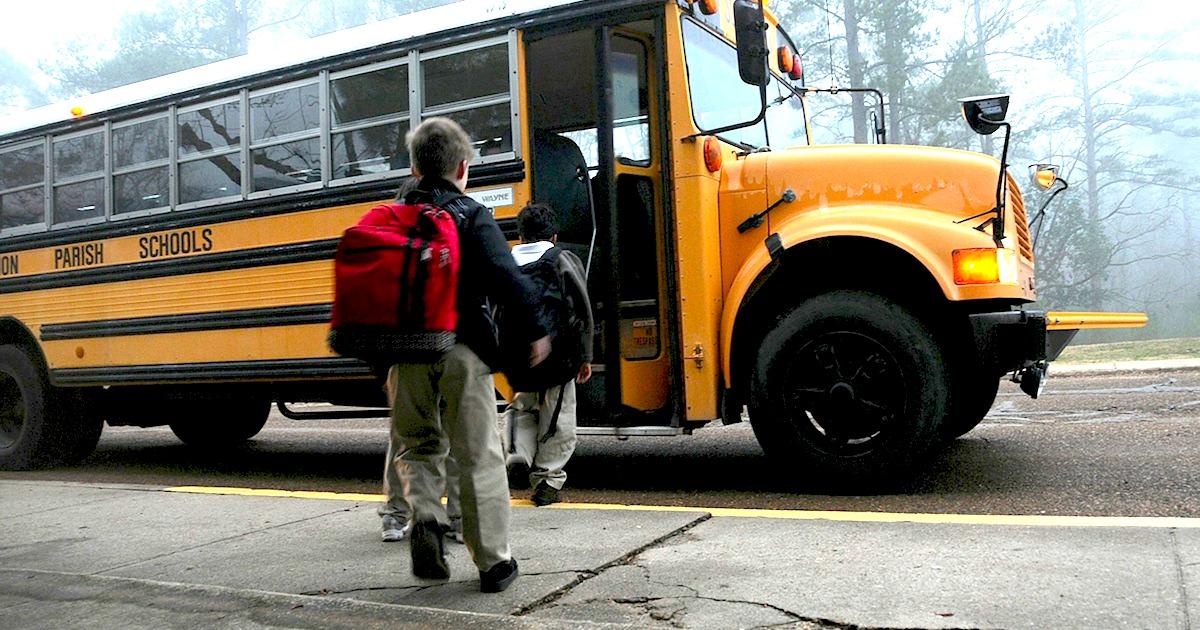 kids walking onto yellow school bus