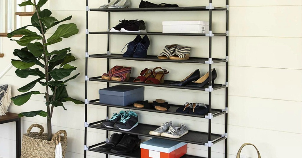 metal shoe rack with plant beside it and house siding behind it