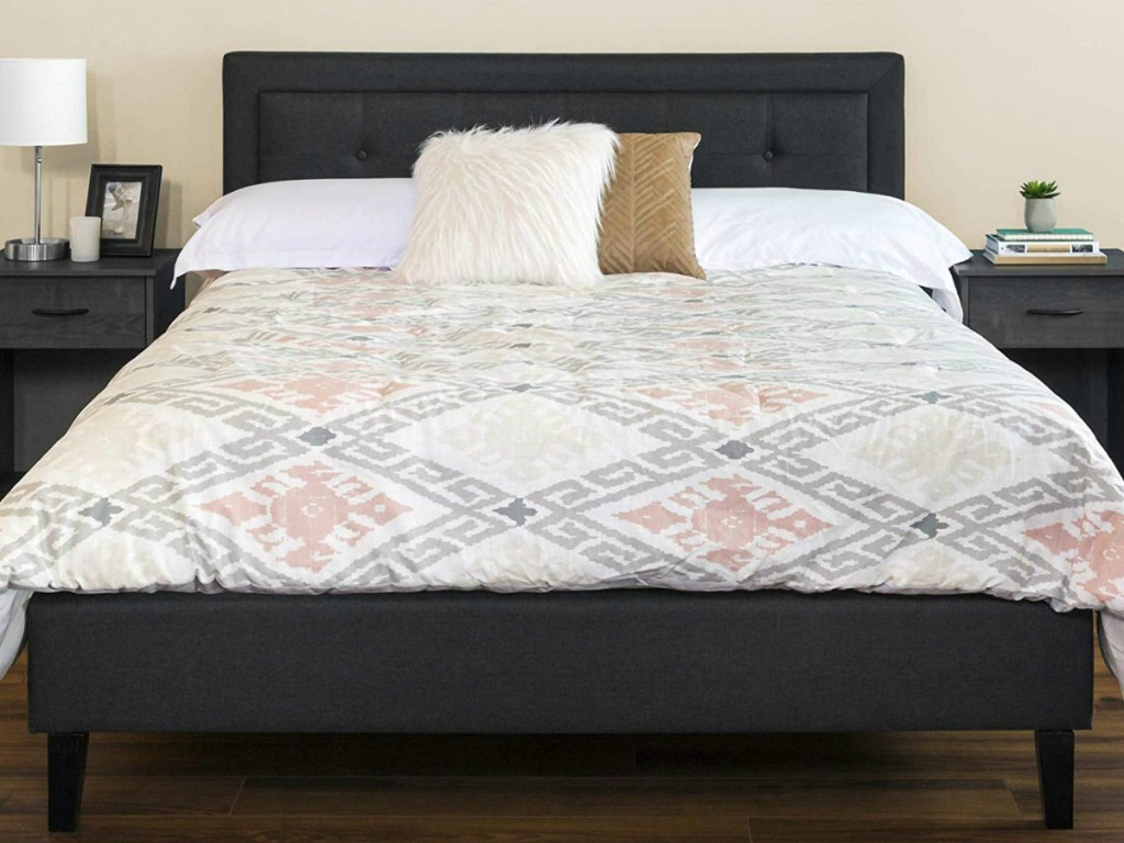 bed with gray/black head board and footbed