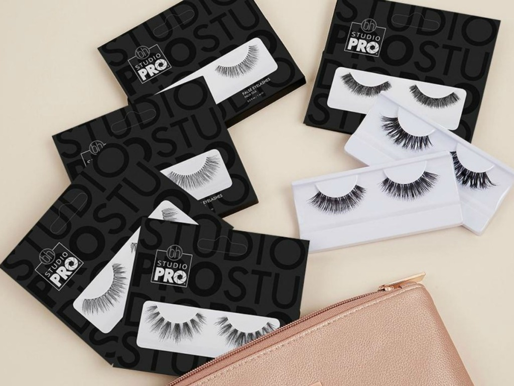 purse with packages of false lashes in packages