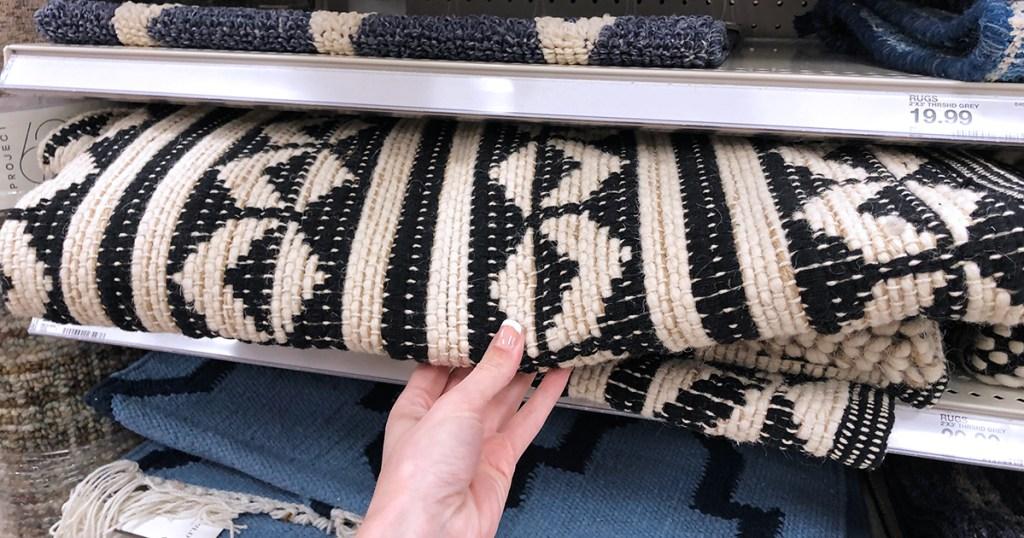 grabbing accenty rug at Target