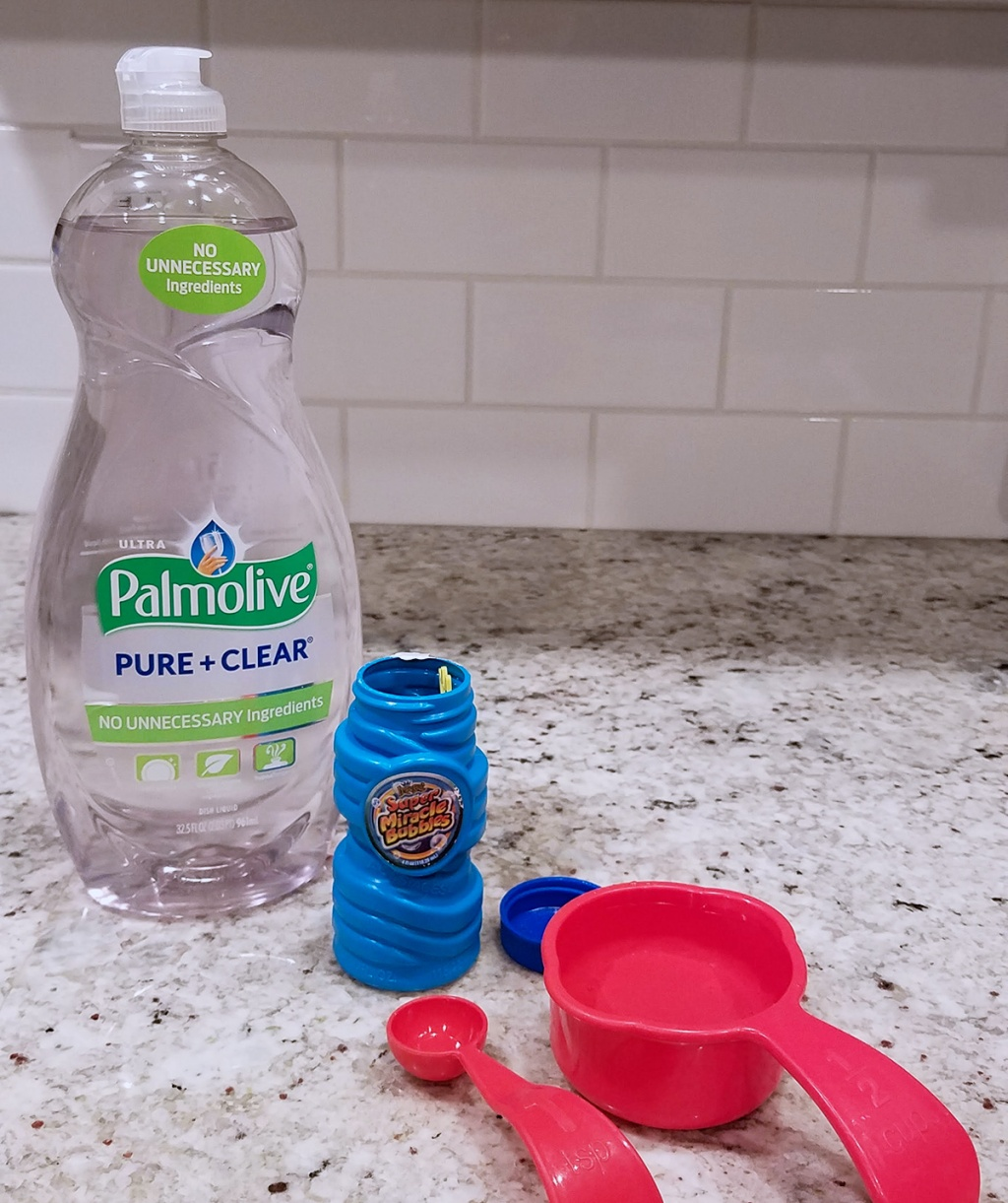 dish soap, water, measuring cups on counter