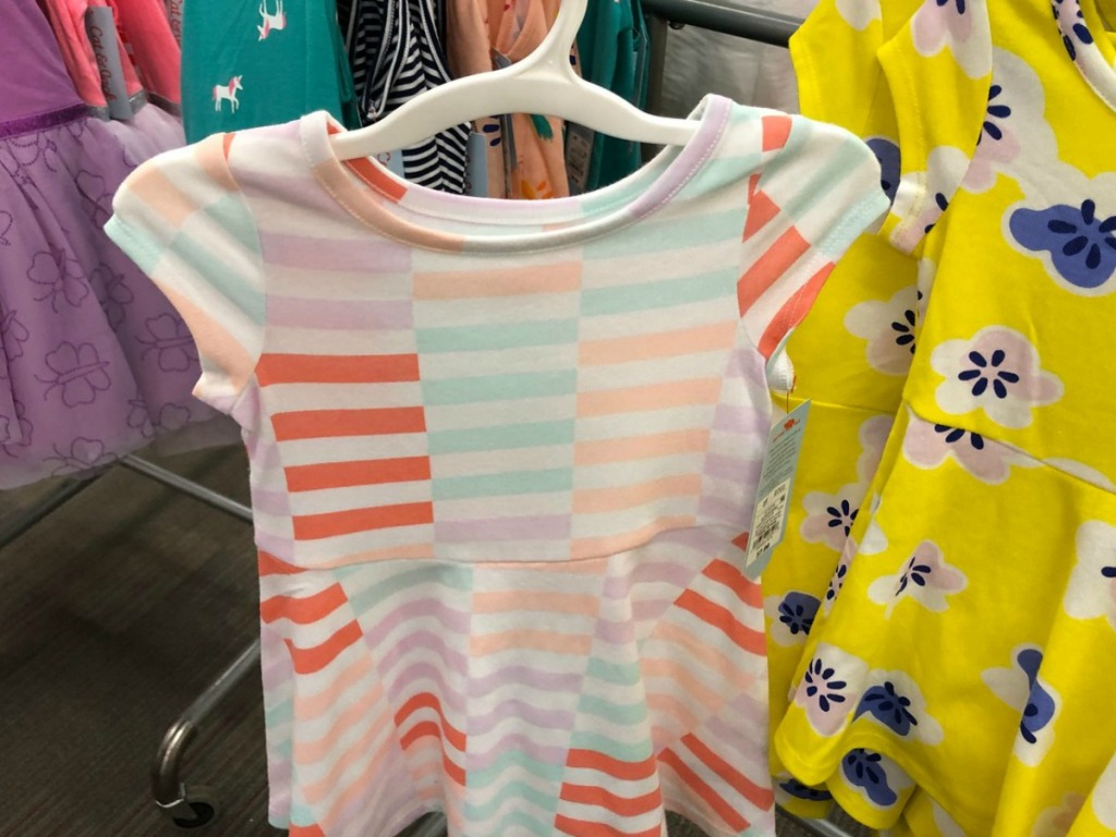 dress with multi-colored stripes on hanger in store