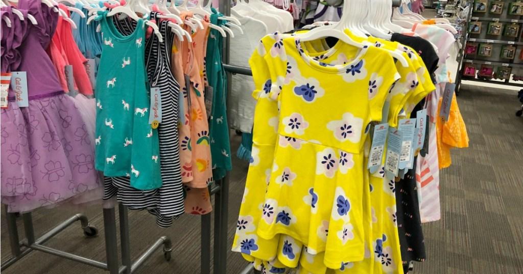 dresses on hangers in store display