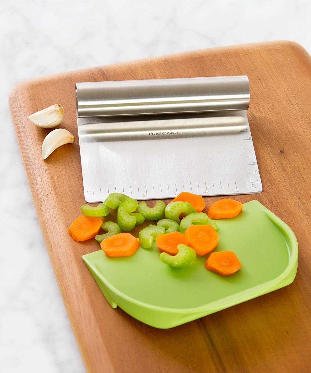 chop tool on cutting board with veggies