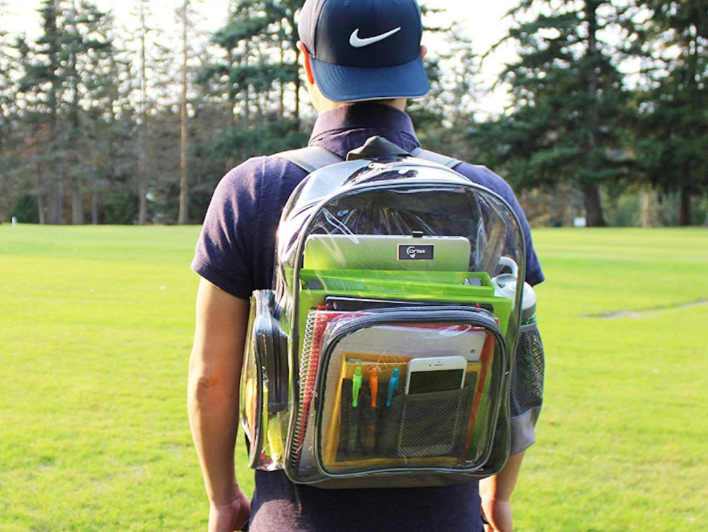 student wearing backwards nike hat and clear backpack