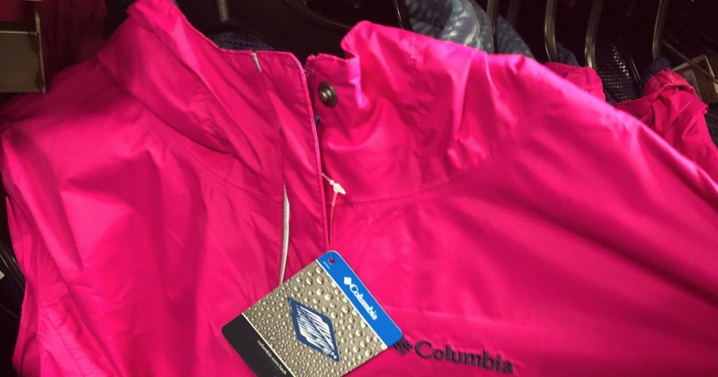 columbia girls rain jacket on a hanger
