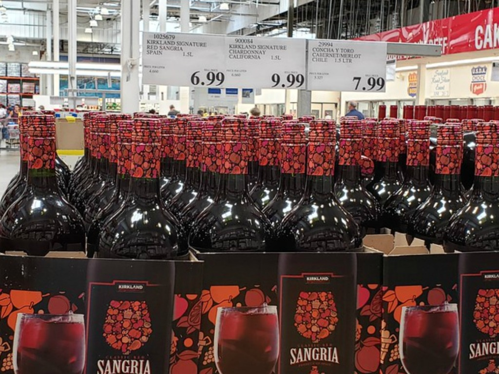 bottles of red wine near price tags in store