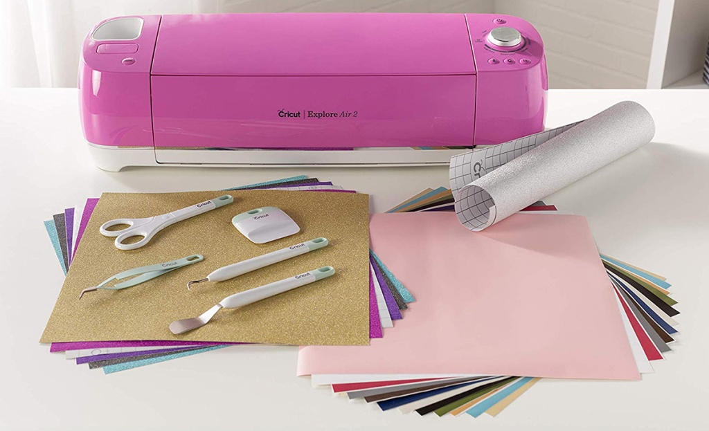 cricut air 2 in fuschia color with accessories and materials