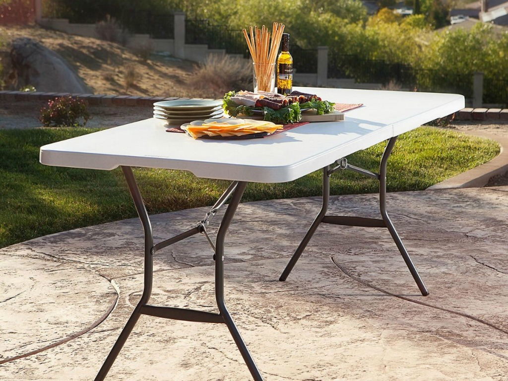 table on patio with food on top