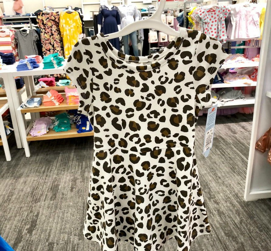 leopard dress hanging up in store