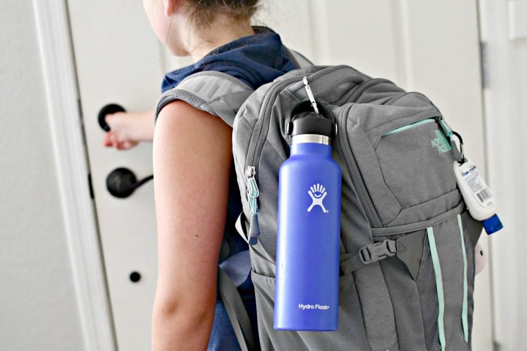 water bottle hanging off backpack