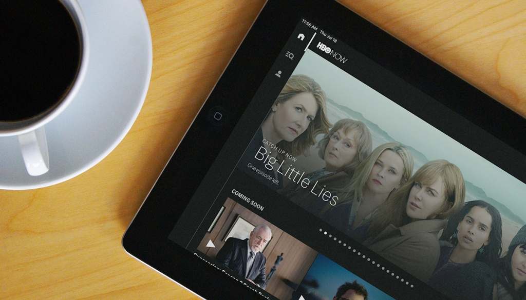 hbo now app on ipad next to cup of coffee