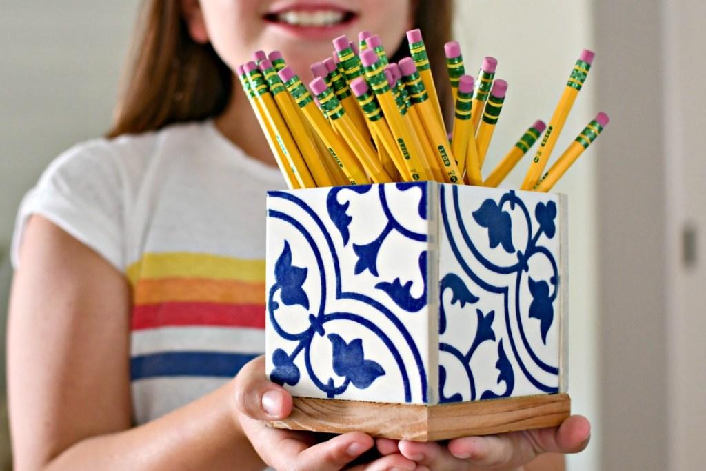holding a diy teachers gift pencil holder