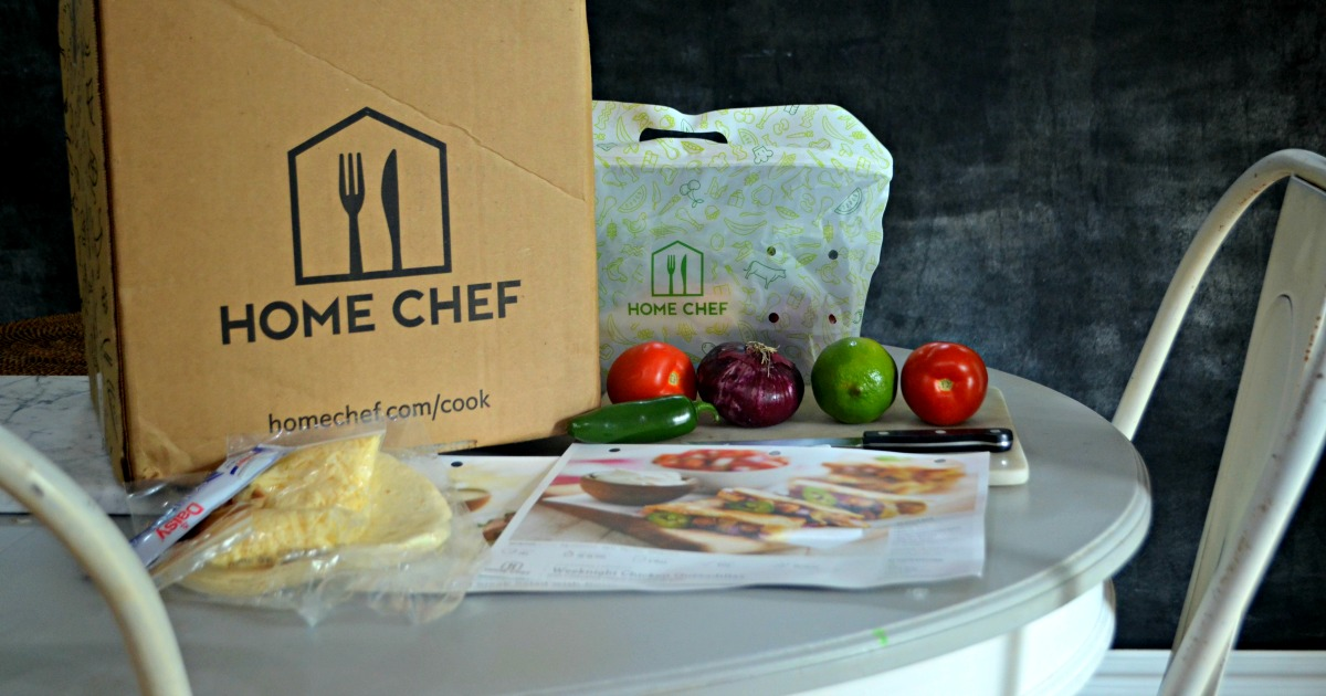 home chef box on table with ingredients around it