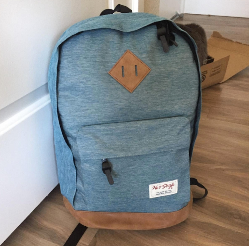 blue backpack sitting on wood floor