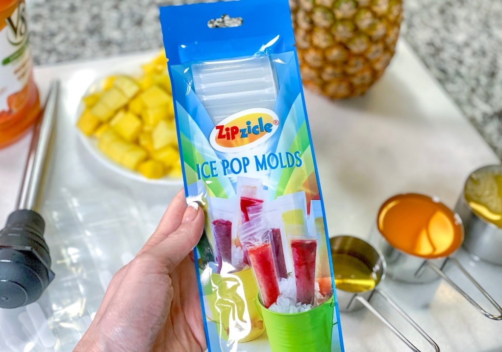 hand holding a pack of ice pop molds