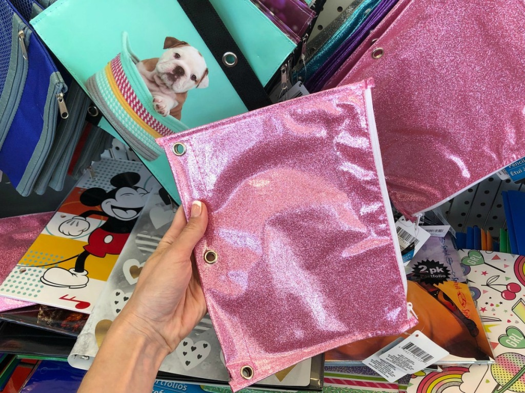 hand holding pink glittery pencil pouch in store