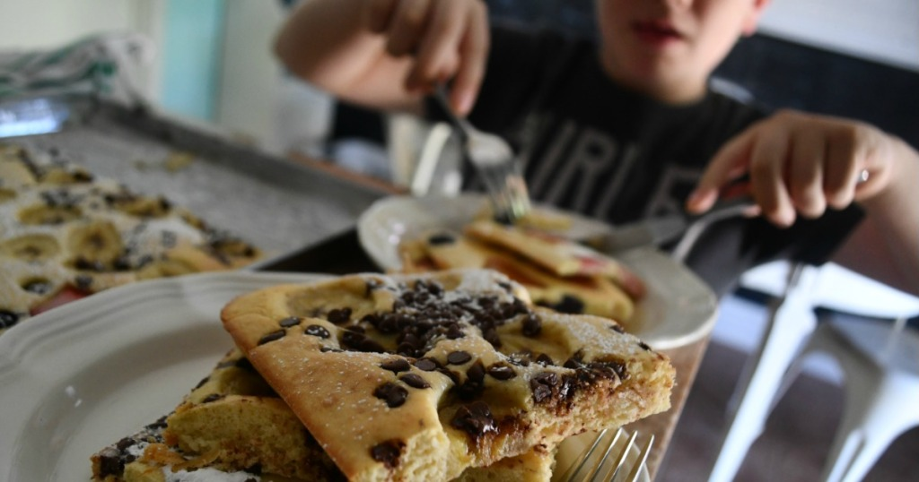Kid eating sheet pan pancakes