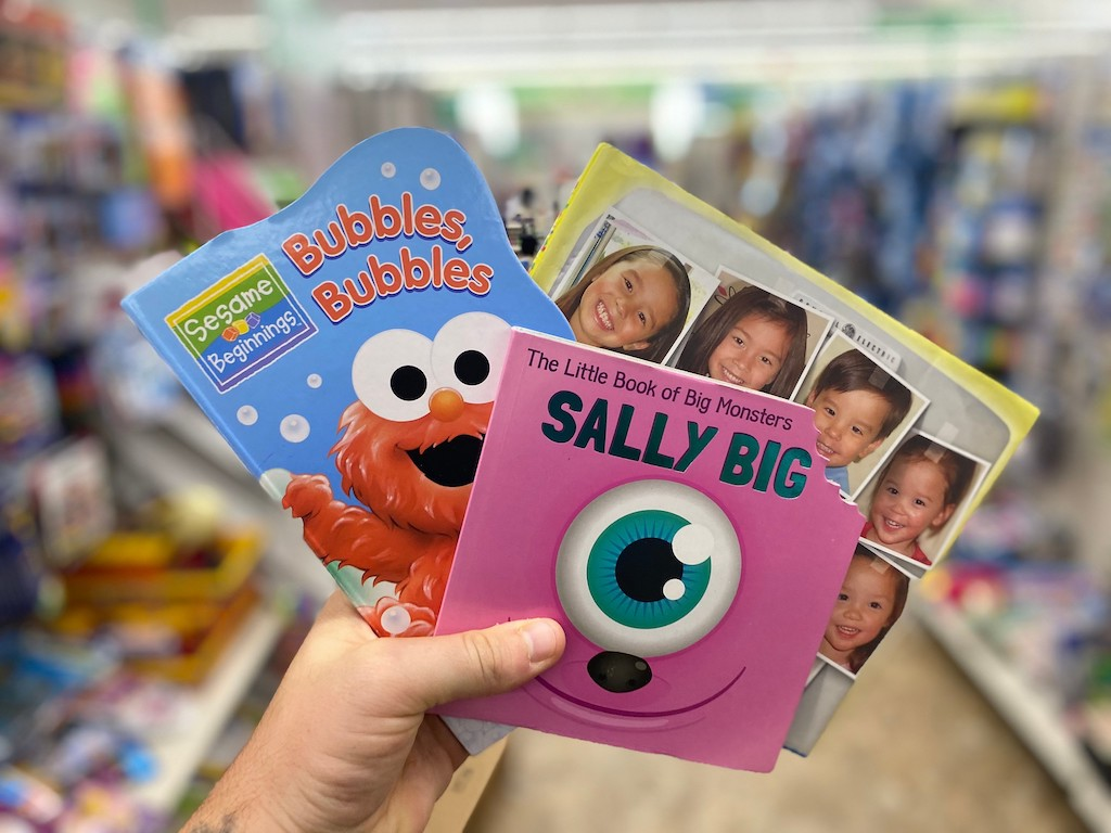 holding kids books at Dollar Tree