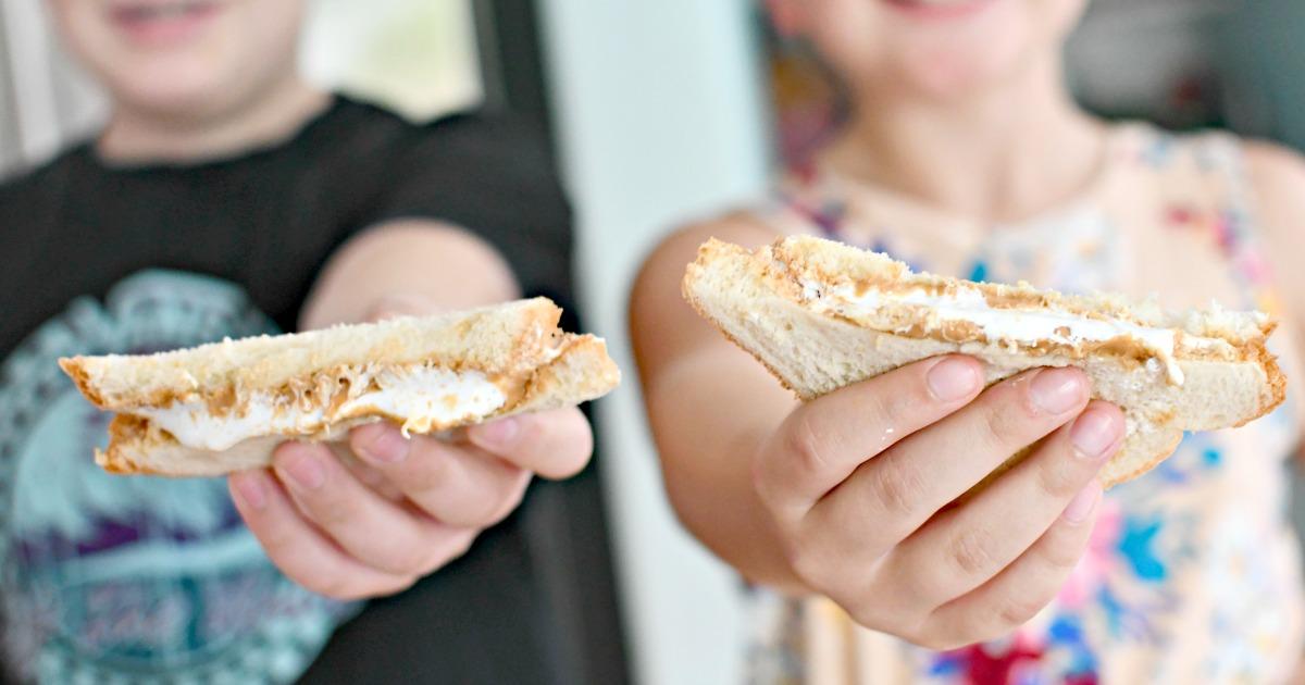 kids holding nutterbutter sandwiches